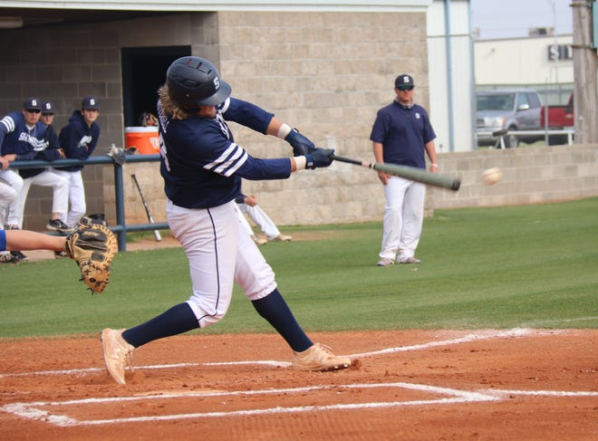 Koby Mitchell connects for a base hit against Harrah Friday.
