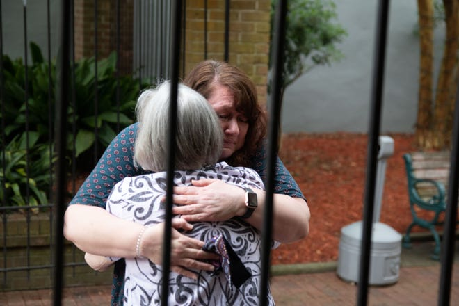 Mary Chason (facing the camera) and her mother Valeria Truitt share a hug for the first time in 14 monhs.