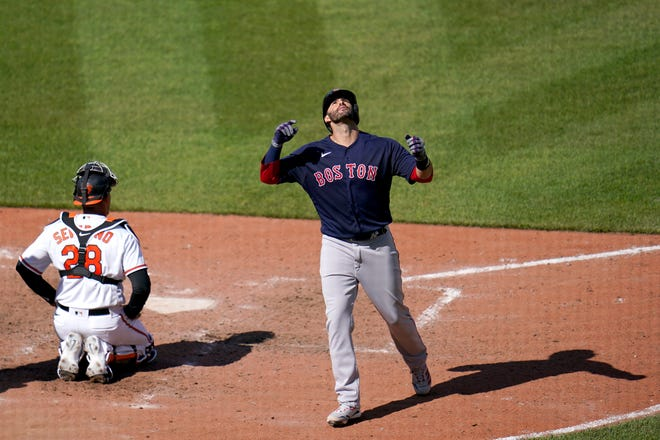 Boston Red Sox's J.D. Martinez reacts after hitting a solo home run — his third home run of the game — off Baltimore Orioles starting pitcher Tyler Wells during the eighth inning on Sunday in Baltimore.