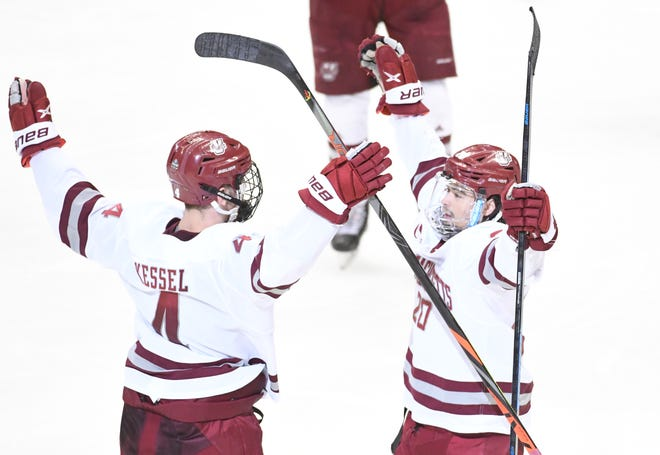 UMass defenseman Matthew Kessel, left, celebrates a second-period goal with Oliver Chau against St. Cloud State in NCAA Division 1 hockey title game in Piittsburgh.