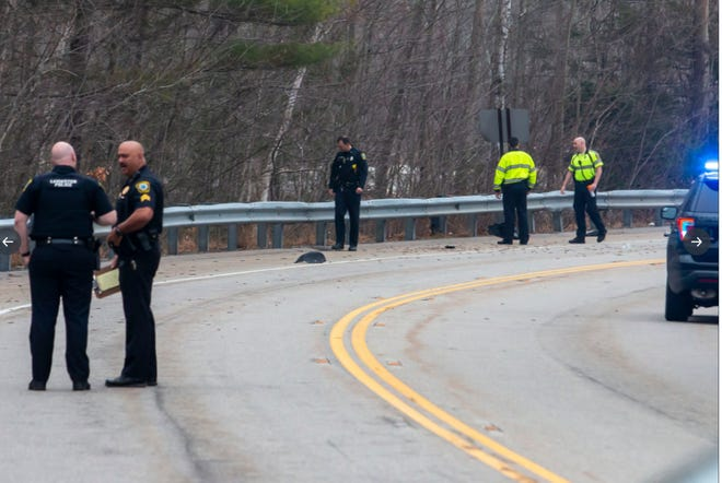 Police at the scene of a fatal motorcycle crash Sunday morning.