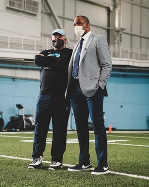 Ahead of his introductory news conference last Tuesday, new UNC men's basketball head coach Hubert Davis (right) met with the football team and head coach Mack Brown (left).