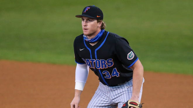 Florida's Kris Armstrong hit a three-run pinch-hit homer to help the Gators defeat No. 6 Tennessee on Sunday.