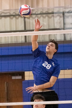Chillicothe's Hayden Cutright spikes the ball over the net to score for Chillicothe during a volleyball match against Loveland on Sat. April 10, 2021, at Chillicothe High School. Chillicothe fell to Loveland 2-0.