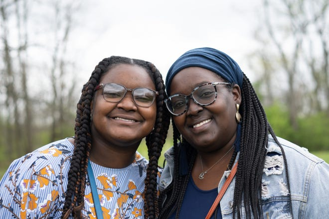 Tamia Palmer, 16, left, and her mother, Tamiko, right, smile together after church, Sunday, April 11, 2021, outside Hope for You Family Life and Worship Center in Cincinnati.