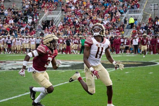 Freshman wideout Malik McClain tracks the ball during FSU's spring game.