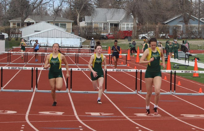 C.M. Russell's Lexi Thornton (right) crosses the finish line ahead of teammates Dylan Simonson (left) and Jasmin Wyman to win the 300-meter hurdles during their dual with Billings West Saturday at Memorial Stadium.