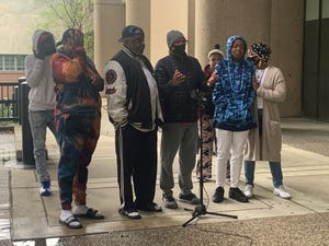 Relatives of Dominique Fels, who was shot and killed in January, gathered with Game Changers' Christopher 2X outside the Hall of Justice on Sunday to call for more communication from Louisville police on the case.