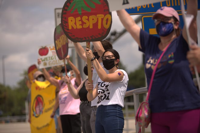 Kaylee Dombrowski, an Florida Gulf Coast University student, joined 20 others in support of farmworkers Sunday. The group stood in front of a Wendy's at Immokalee Road and Airport-Pulling Road. Wendy's has not joined the Coalition of Immokalee Worker's Fair Food Program, which is aimed to prevent farmworker abuse.