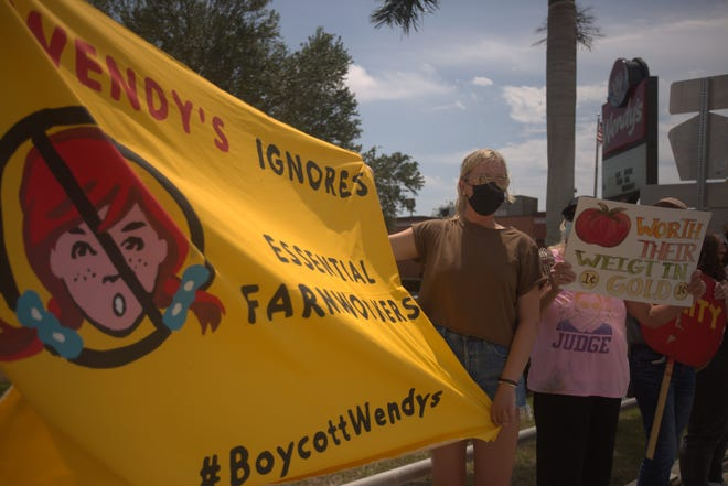 Julia van Fleet of Naples joined 20 others in support of farmworkers Sunday. The group stood in front of a Wendy's at Immokalee Road and Airport-Pulling Road. Wendy's has not joined the Coalition of Immokalee Worker's Fair Food Program, which is aimed to prevent farmworker abuse.