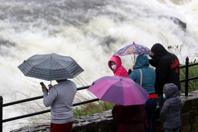 People came to watch the Great Falls, in Paterson, as it was raining, Sunday, April 11, 2021.