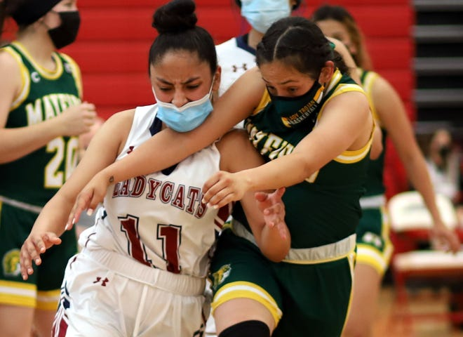 Senior Lady 'Cat guard Jasmine Lopez (11) battles a Mayfield defender for a loose ball during Saturday's District 3-5A basketball game at Deming High School. Mayfield won the game 61-34.