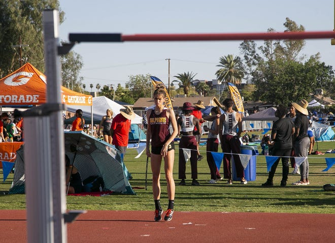 April 9, 2021; Chandler, AZ, USA; Salpointe Catholic High's Paris Mikinski competes in the high jump at the 81st Chandler Rotary Invitational Track and Field Meet at Chandler High School on April 9, 2021. Credit: Meg Potter/The Arizona Republic