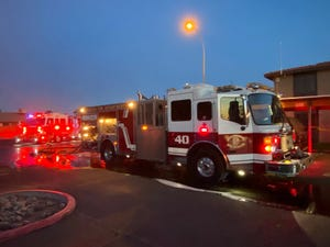 Phoenix fire crews arrive at the scene and put out the fire on April 10, 2021.