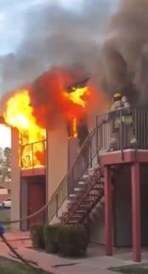 Flames as high as 10 feet burn an apartment in Phoenix on April 10, 2021.