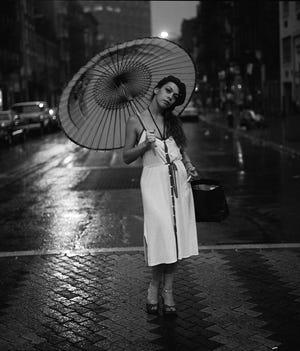 Rickie Lee Jones with umbrella.