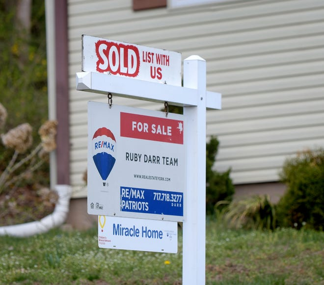 """A """"sold"""" sign sits outside a home on Park Street in Loganville Sunday, April 11, 2021. Bill Kalina photo"""