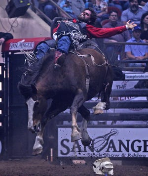 Luke Creasy competes in the bareback event at the San Angelo Rodeo in the Foster Coliseum on Saturday, April 10, 2021.