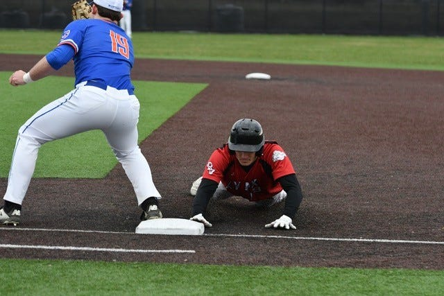 Peyton Carroll slides back into first base on Saturday, April 10. Brandon Valley went on to defeat Fargo South 18-7.