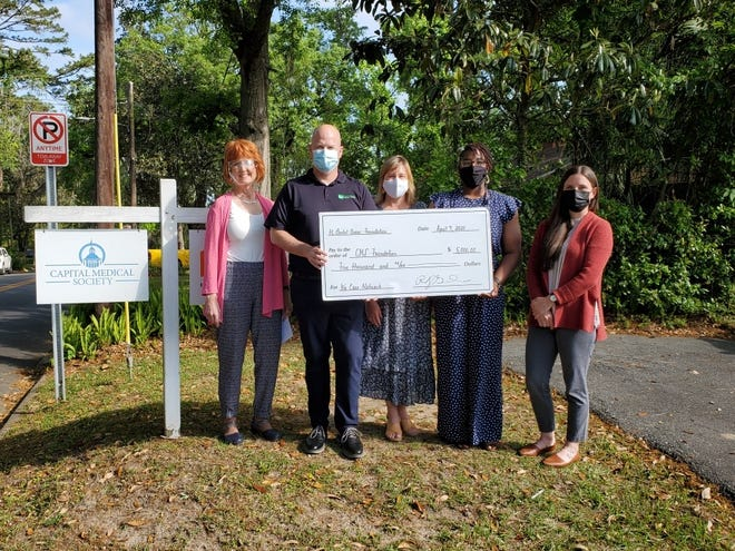 From left: Pam Irwin, Executive Director, Capital Medical Society Foundation; Greg Gruber, Chief Financial Officer, Florida Dental Association; Kristin Badeau, Foundation Coordinator, Florida Dental Association Foundation; Roshanda Dorsey, Senior Case Manager and Dental Coordinator, We Care Network; and Diana Bixler, Program Coordinator, We Care Network. We Care Network at check presentation.