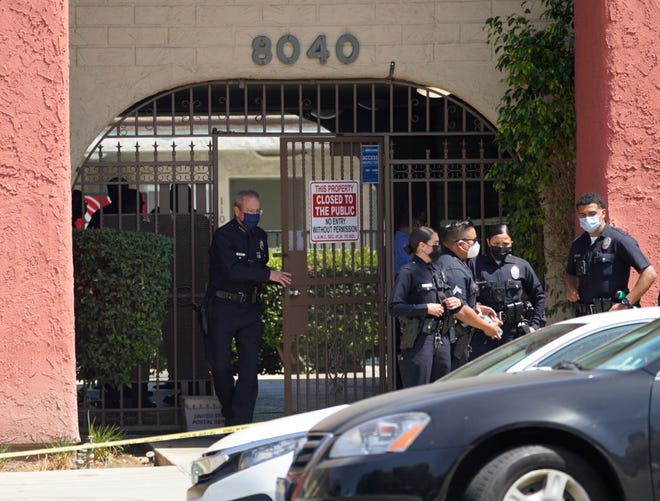 Los Angeles Police Chief Michel Moore exits an apartment complex as police investigate in Reseda, Calif., Saturday, April 10, 2021. The mother of three children -- all under the age of 5 --  found slain inside a Los Angeles apartment Saturday morning has been arrested, police said.