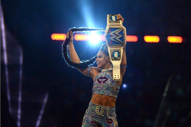 Bianca Belair celebrates winning the Smackdown Women's Championship match at WrestleMania 37 at Raymond James Stadium.