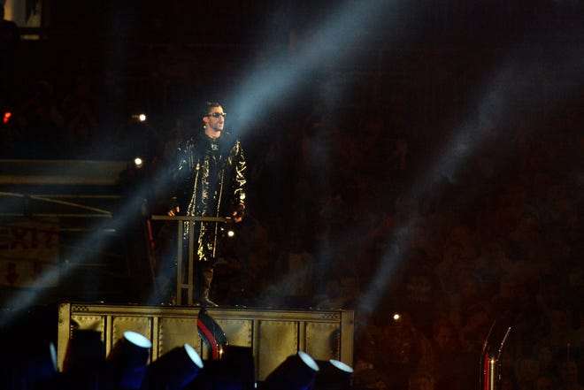 Rapper Bad Bunny makes his entrance into Raymond James Stadium on top of a big rig.