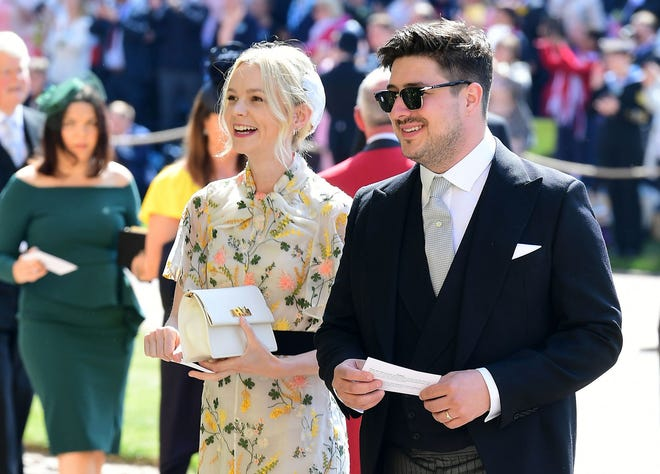 British musician Marcus Mumford and British actor Carey Mulligan arrive for the wedding ceremony of Britain's Prince Harry, Duke of Sussex and US actress Meghan Markle at St George's Chapel, Windsor Castle, in Windsor, on May 19, 2018. / AFP PHOTO / POOL / Ian WestIAN WEST/AFP/Getty Images ORIG FILE ID: AFP_1555RC