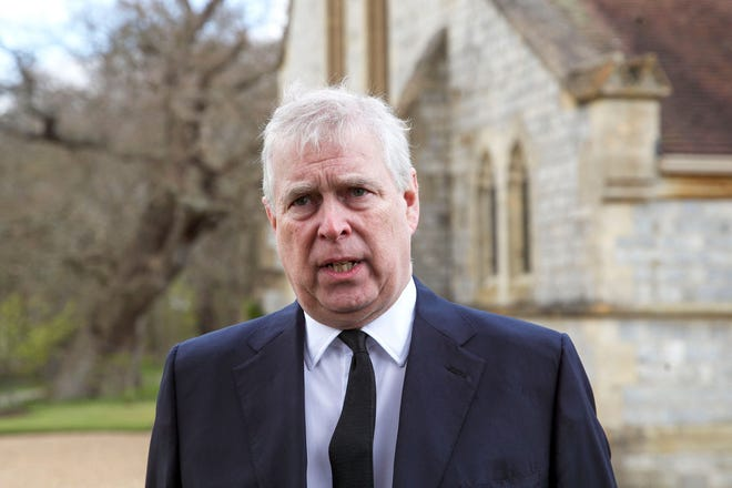 "Two days after his father's death, Prince Andrew tells reporters outside the Royal Chapel of All Saints in Windsor that the loss of Prince Philip has left ""a huge void"" in Queen Elizabeth II's life."