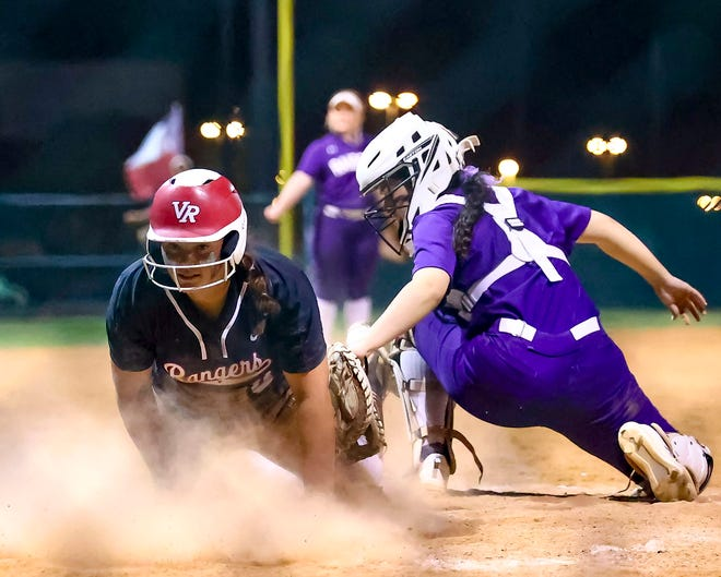 Ashley Borgognone, left, slides safely home for Vista Ridge against first-place Cedar Ridge in the bottom of the sixth inning during a 25-6A game April 9 at Vista Ridge High School. Vista Ridge won the game 7-6 over Cedar Ridge, with Borgognone's run proving to be the winning run.