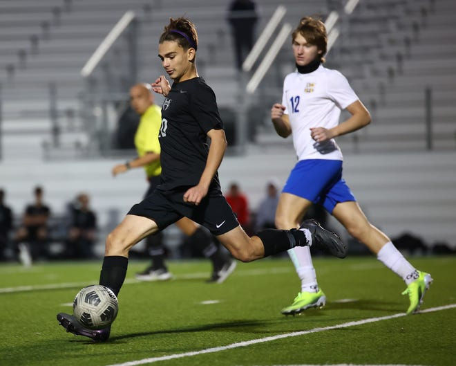 Hendrickson's Jordan Franco, left, moves the ball downfield in a playoff win over Anderson earlier this month. Franco's penalty kick in the Class 5A Region III semifinals lifted the Hawks into a regional championship for the first time, but Hendrickson fell to No. 3 Kingwood Park to end the best season in school history.