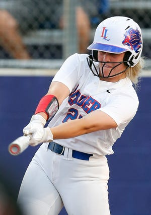 Leander outfielder Baylea Brandon, taking a swing against Liberty Hill on Friday, will play college softball at LSU. She leads the team in home runs and RBIs.