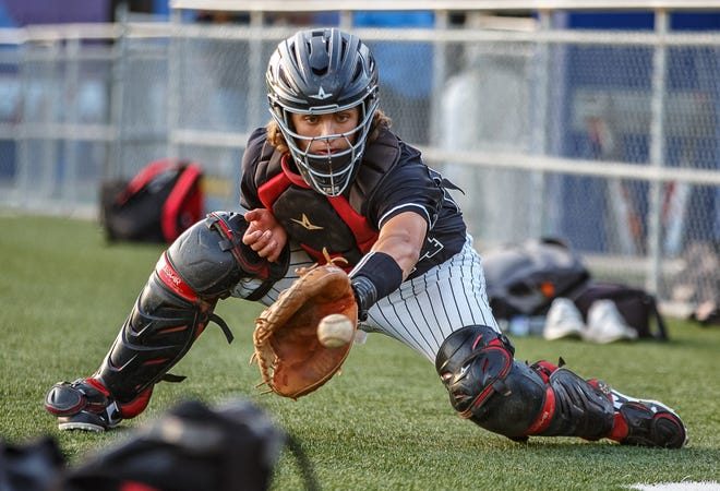 Bowie catcher Travis Starkey, warming up before a game against Westlake, said sweeping the Chaparrals has been his favorite baseball memory.