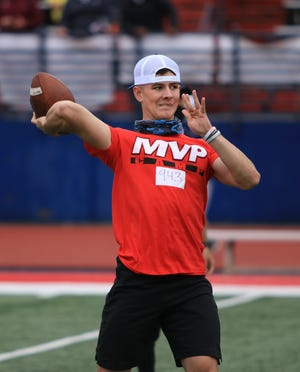 Oconee County quarterback Jacob Wright throws a ball during the MVP Camp at Milton High School.