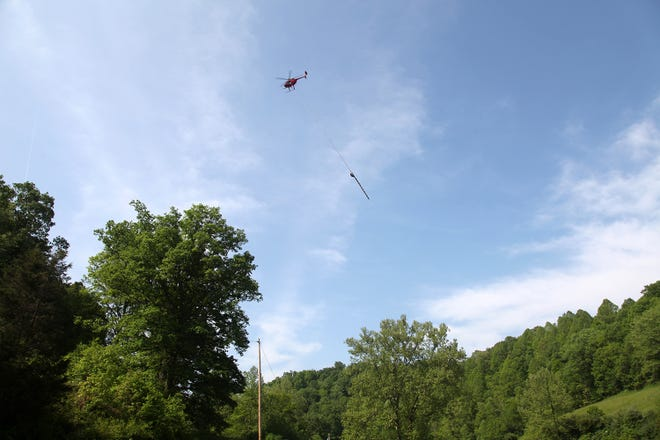 Ohio Edison will be using aerial saws hanging from helicopters to trim hard-to-reach trees. Tree trimming helps prevent weather-related outages.
