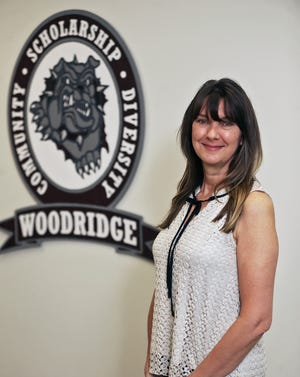 Dina Voinovich, a fifth grade teacher at Woodridge Elementary School, is a Make the Grade Amazing Teacher.