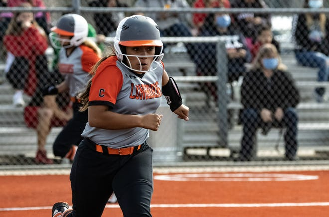 Caprock catcher, Aliyiah Alaniz, makes her way to first base following a base hit against Tascosa last month. Alaniz has homered once during the District 3-5A schedule. [Ben Jenkins/for the Amarillo Globe-News]