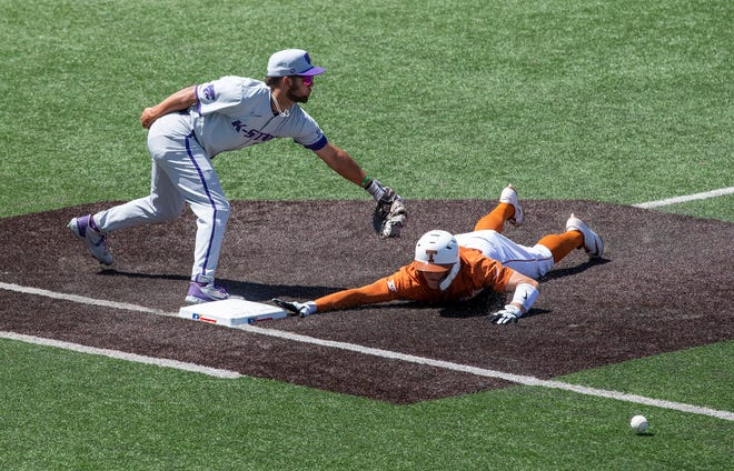 Kansas State's Daniel Carinci misses the ball to tag out Douglas Hodo III at UFCU Disch-Falk Field on Sunday. Since that win over Kansas State, the Longhorns have won two more against Nevada. Hodo had a home run and scored the winning run in Wednesday's win over the Wolf Pack.