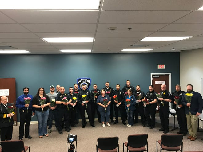 Ashland police officers, dispatchers and clerks received flowers from the Norma Foundation at an awards ceremony this month.
