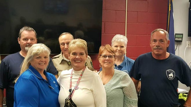 Susanne Peeples, center, was recently named S.C. Emergency Management Director of the Year. She is surrounded by her coworkers and other Hampton County officials.