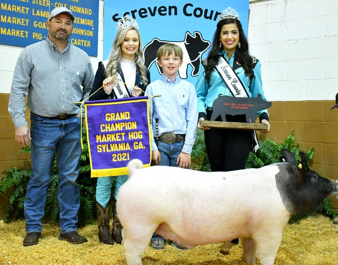 DC Burke was the winner with his grand champion market hog on April 6. Burke stands here with his pig, judge Bryant Oliver, 2021 Queen Jada Kate Monroe, and 2020 Queen Alana Milner. Burke is a student at Screven Christian Academy.