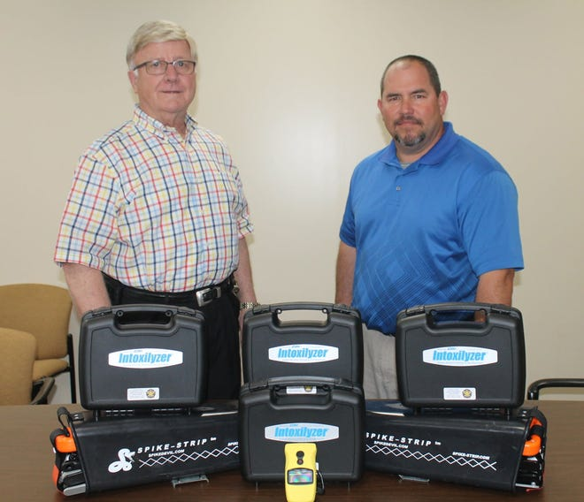 Jefferson County Sheriff Gary Hutchins and Chief Deputy Col. Tim Moore stand with some equipment the United States Deputy Sheriff's Association (USDSA) donated to the department. The organization receives donations and then buys equipment for smaller, rural law enforcement agencies that can't afford the equipment. The USDSA donated four handheld alcohol testers and two spike strips valued at almost $4,000 total.