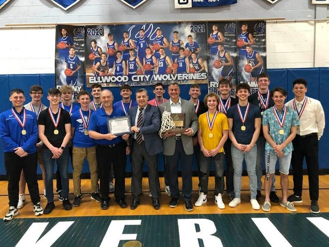 Ellwood City Mayor Anthony Court recently presented a proclamation to the Wolverines basketball team after it captured the school's first WPIAL Championship in its history. Left to right are district athletic director Curt Agostinelli, head coach Steve Antuono, coach Ricky Roth, Court and the Wolverines basketball team.