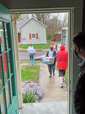 Volunteers for The Center Project carry items into the mid-Missouri LGBTQ resource center's new location Saturday at 805 Fairview Ave. The organization announced the move Sunday.