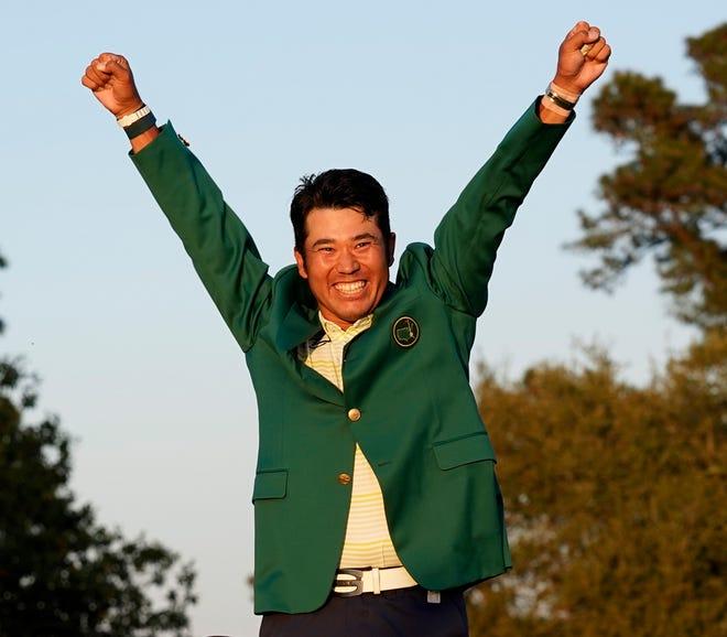 Hideki Matsuyama, of Japan, celebrates after putting on the champion's green jacket after winning the Masters golf tournament on Sunday.