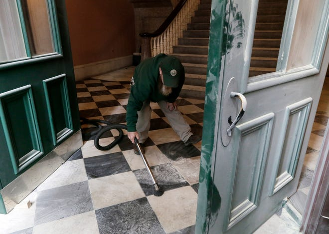 Workers cleaned up the aftermath of a man who broke three windows at the Ohio Statehouse overnight and sprayed a fire extinguisher in the rotunda before placing a call to 911.