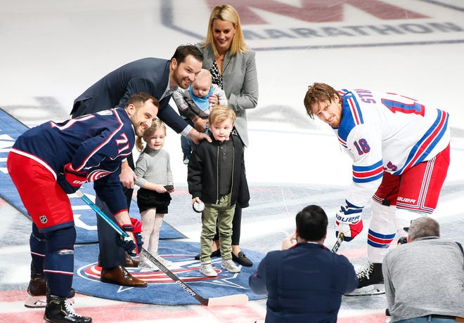 Rick Nash and his family pose with Blue Jackets left wing Nick Foligno (71) and Rangers defenseman Marc Staal before a game at Nationwide Arena on Jan. 13, 2019.