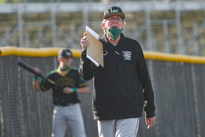 Lake Minneola High School baseball coach Kerry Whetro calls out to his players during a game against East Ridge on April 1 in Clermont. [PAUL RYAN / CORRESPONDENT]