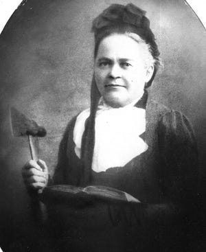 """Carrie """"Carry"""" Nation fought against alcohol and for women's rights in southwest Kansas in the late 1800s and early 1900s, seen here with her trademark hatchet she used to take out saloons."""