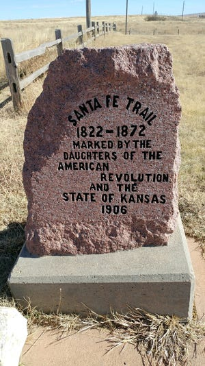 The DAR Marker at the Santa Fe Trail tracks is located at the Santa Fe Trail rut site west of Howell on Highway 50 in Ford County.